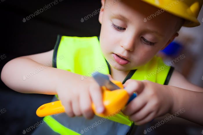 Boy playing as a foreman