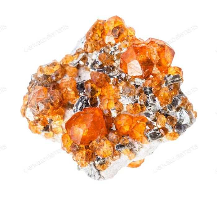 raw Spessartine garnet crystals on rock isolated