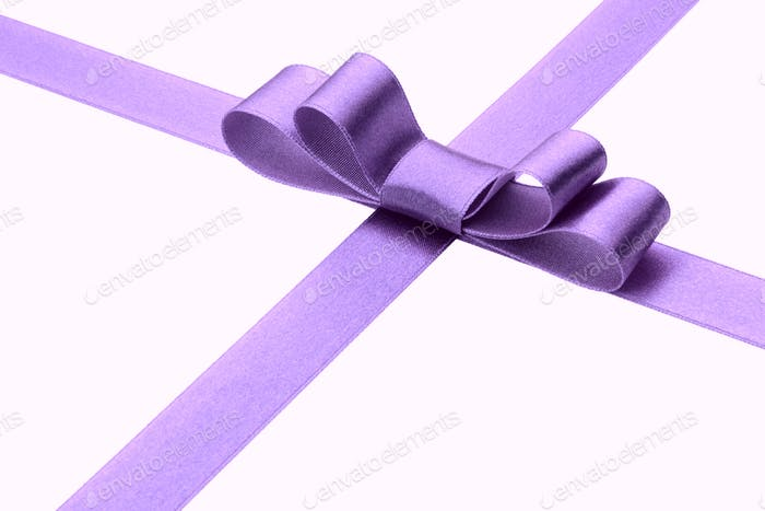 Festive lilac  gift ribbon and bow isolated on white background