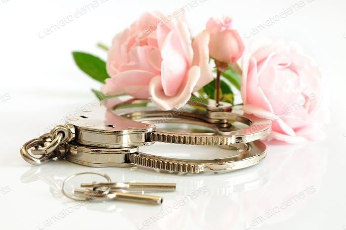 Close-up chrome handcuffs and keys