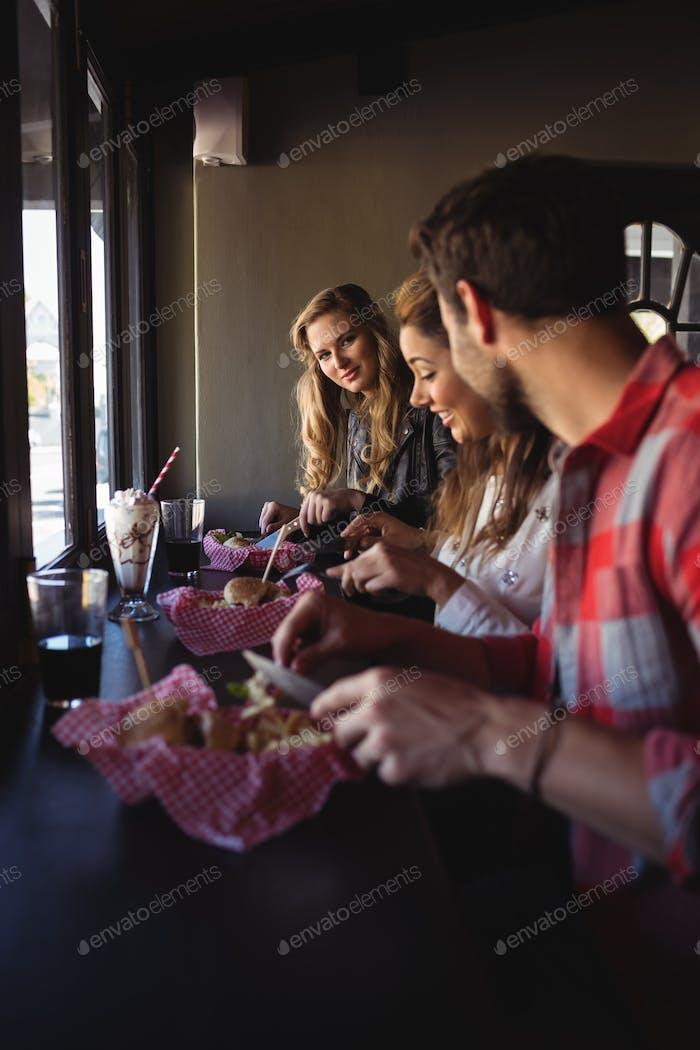 Friends having burger together