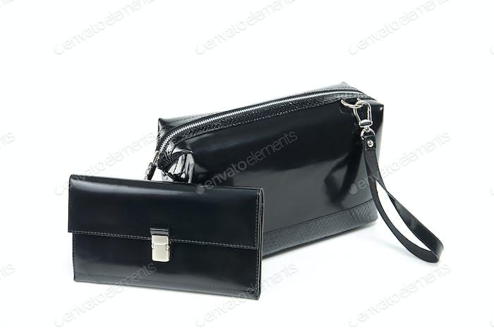 Glancy Kosmetiktasche und Geldbörse auf weißem Hintergrund