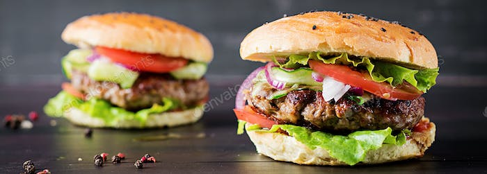 Big sandwich - hamburger burger with beef,  tomato,  red onion a