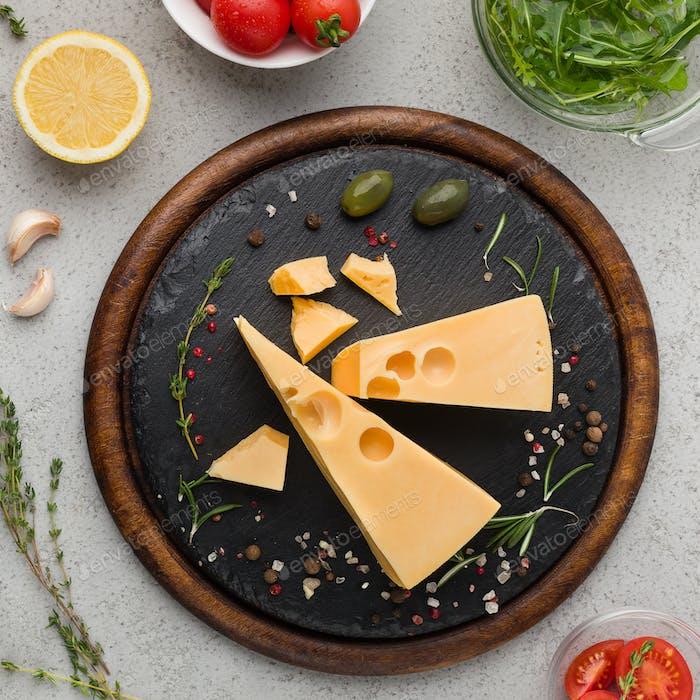 Maasdam cheese on board