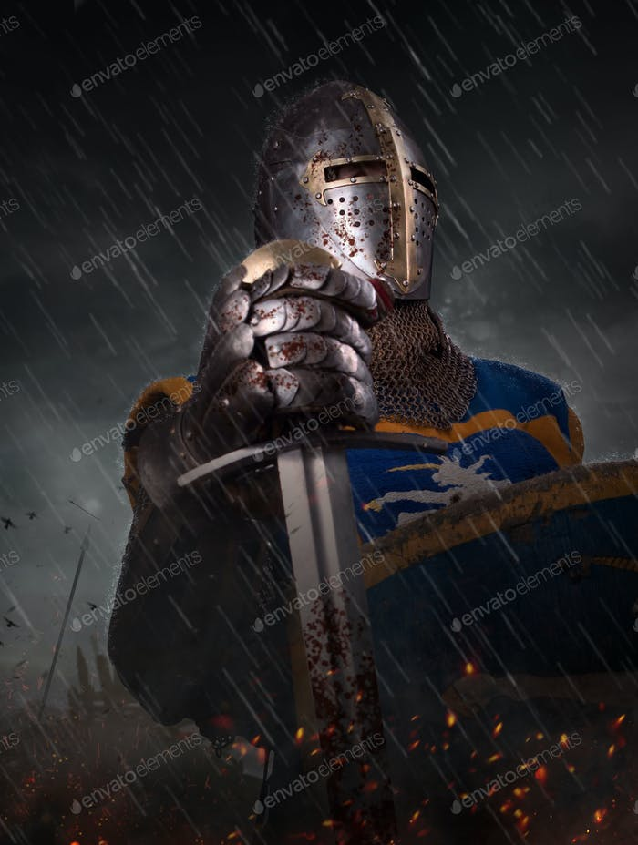 A knight with sword under the rain on battlefield.