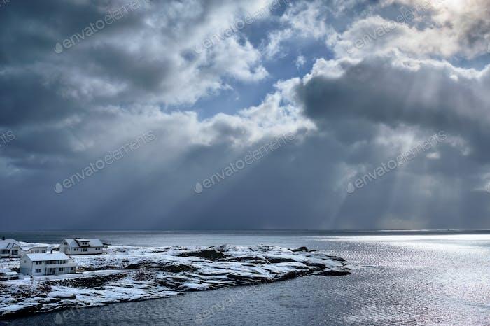 Norwegian sea in winter with sun rays