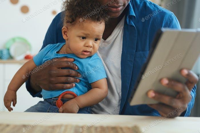 Baby Boy Looking at Digital Tablet