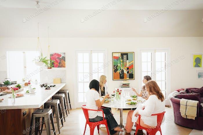 Four women friends having lunch.