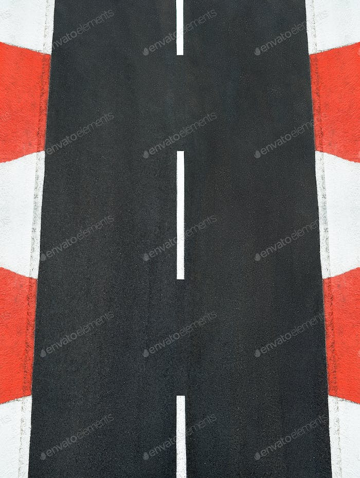Texture of motor race asphalt and curb Grand Prix track