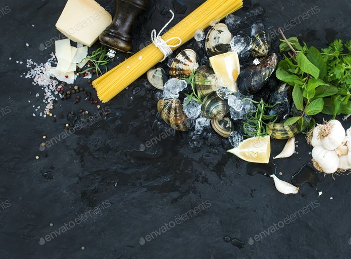 Ingredients for cooking Spaghetti vongole. Clams on chipped ice, raw pasta, Parmesan cheese