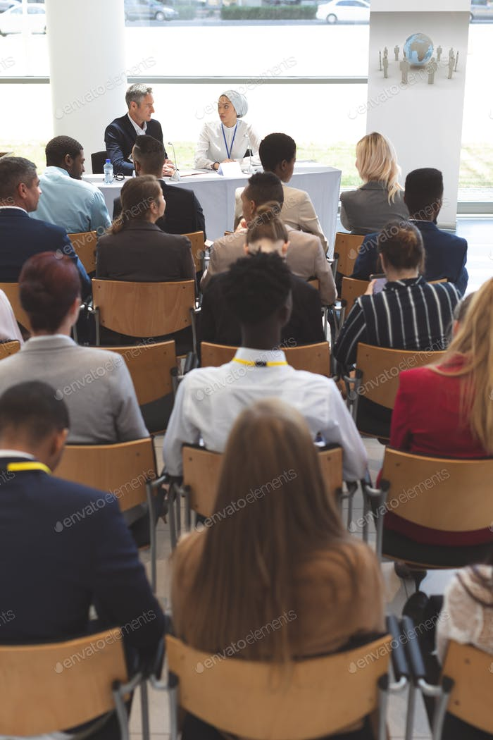 Group of business people waiting while attending a business seminar in office building