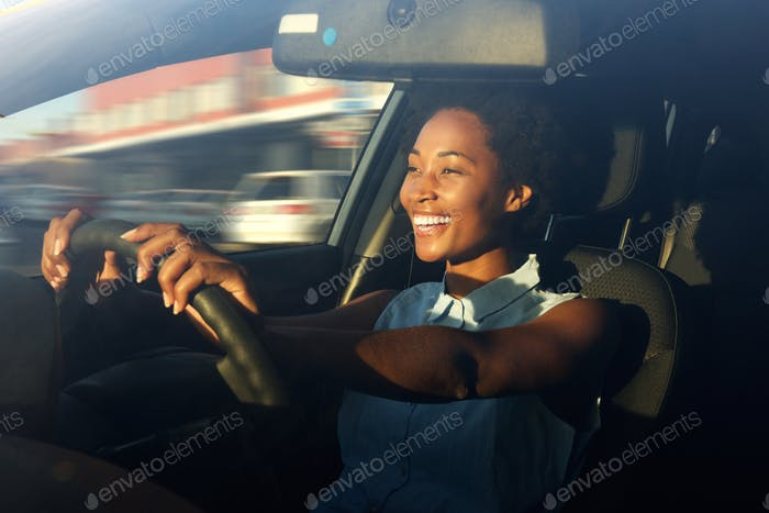 Young african american woman driving a car