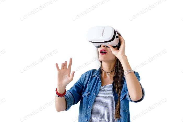 Woman with VR glasses studio shot