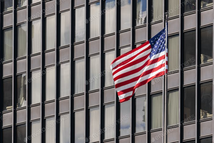 American national flags over the Chicago building cityscape, independence day