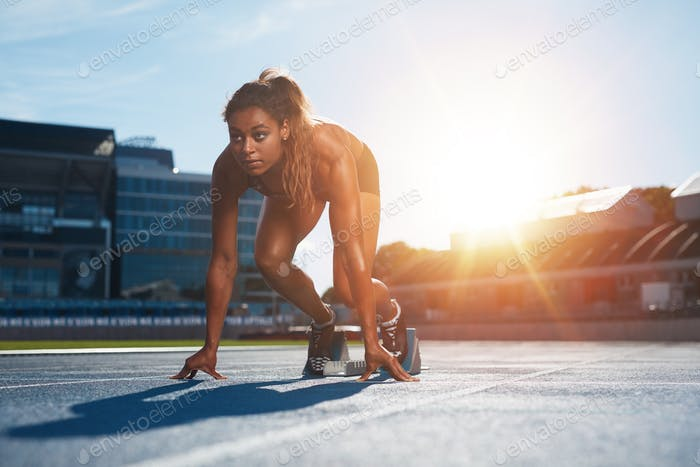 Woman about to start a sprint