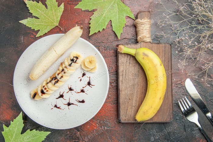 top view delicious banana with sliced pieces inside plate on a dark background tree photo fruit