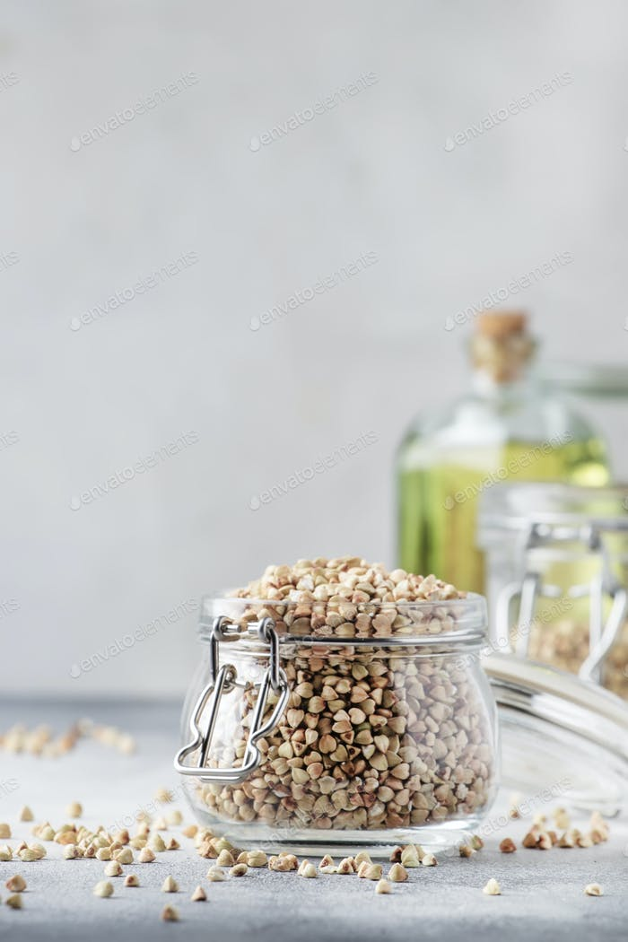 Raw green buckwheat in jar