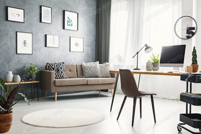 Bright Home Office Interior With A Sofa