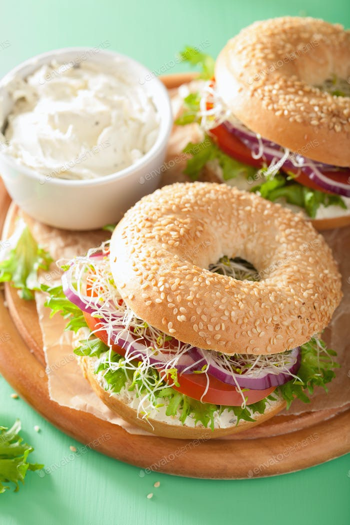 tomato sandwich on bagel with cream cheese onion lettuce alfalfa