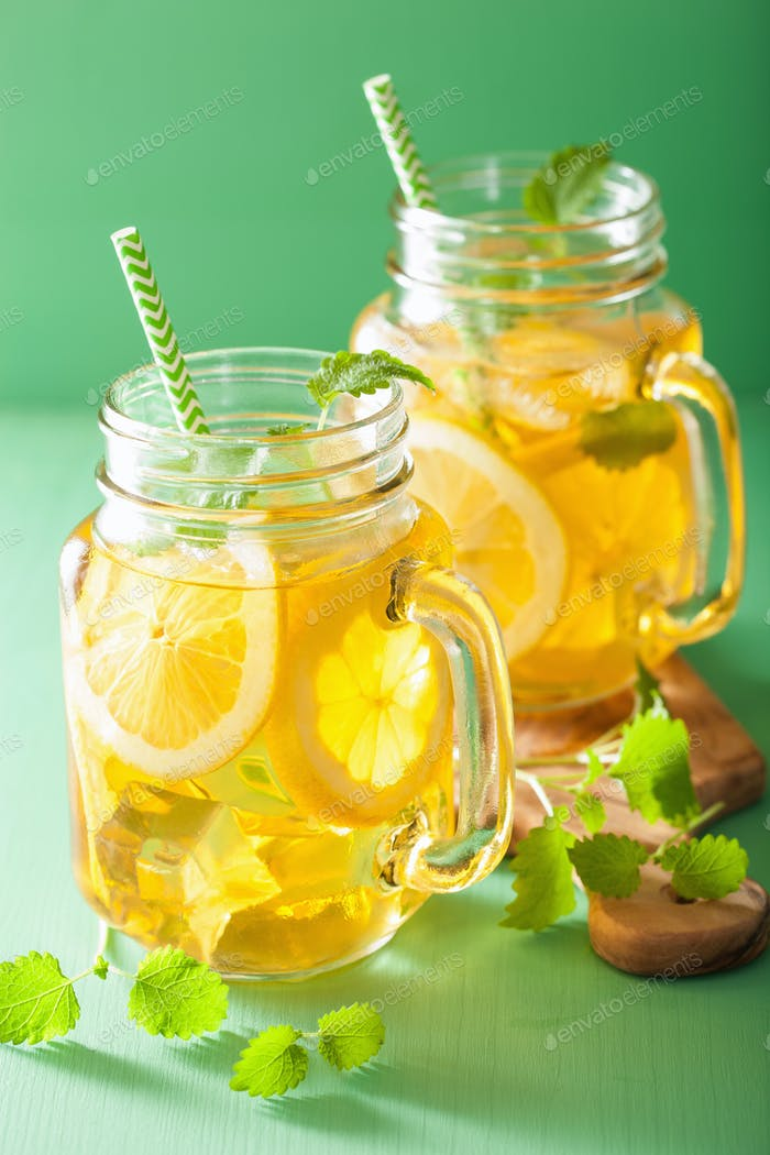 ice tea with lemon and melissa in mason jars