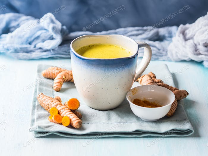 Golden turmeric milk drink in mug