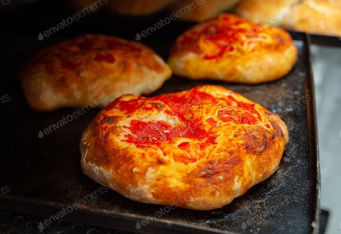 Mini pizza with tomato sauce