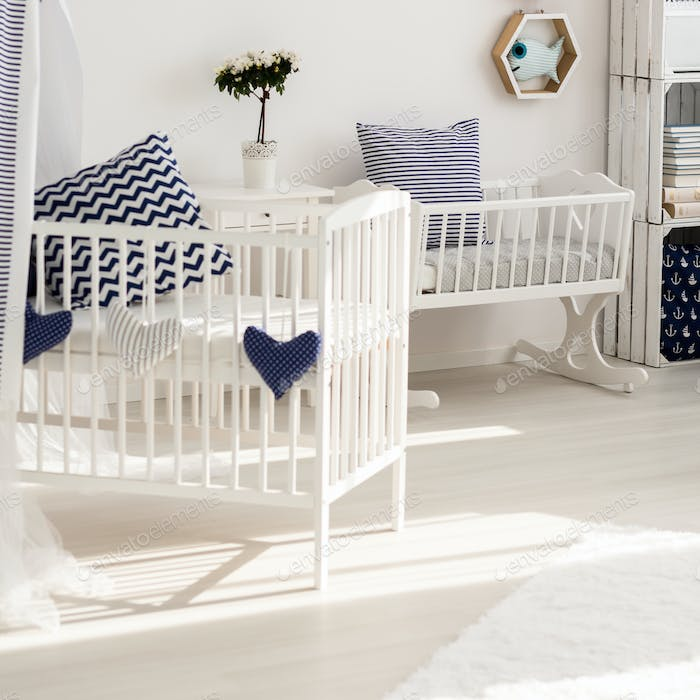 White infant room with marine decorations