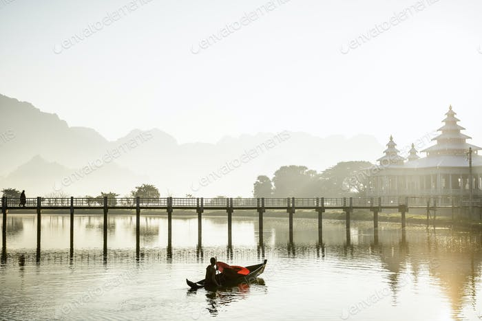 55012,Mountains and bridge reflected in still lake, Hpa an, Kayin, Myanmar