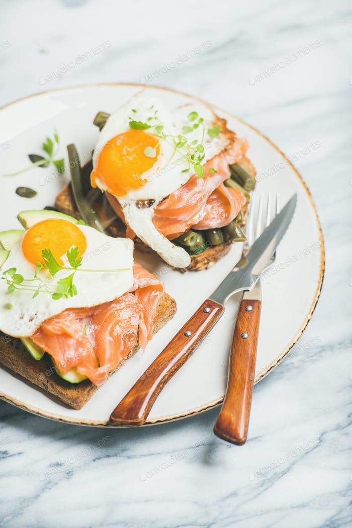 Healthy breakfast sandwiches in plate over marble background