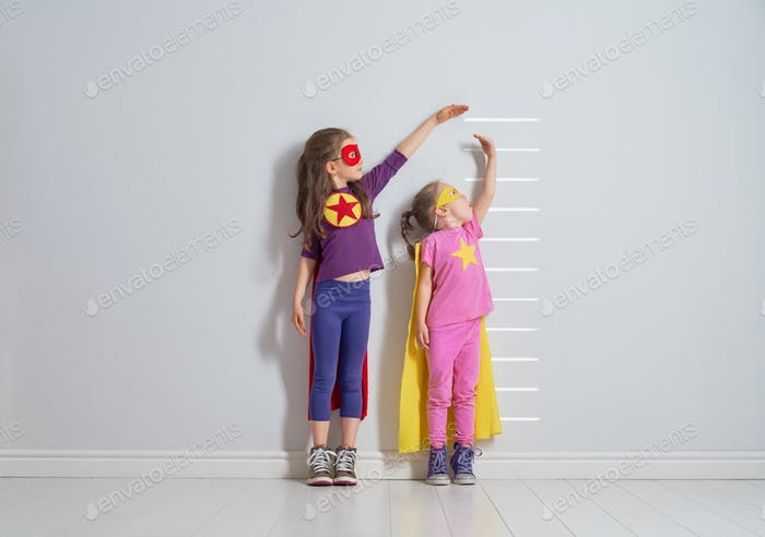 children are playing superhero