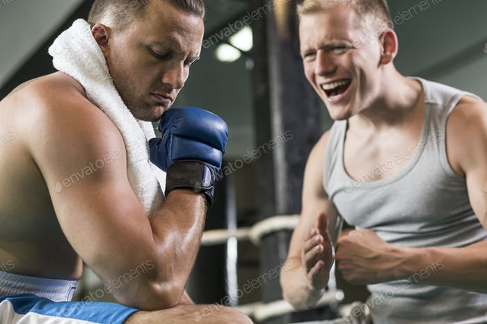 Trainer motivating boxer during training