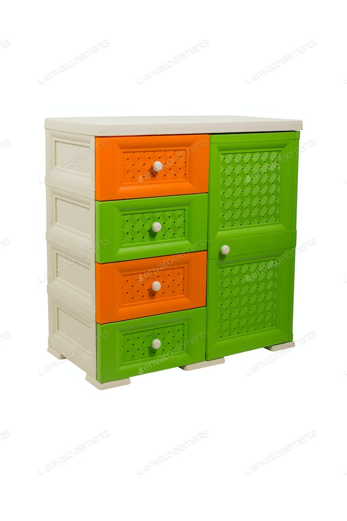 Three-color plastic chest of drawers on a white isolated background