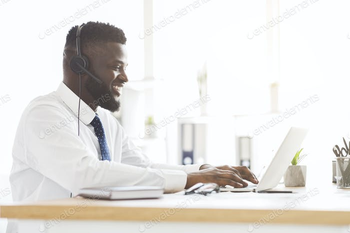 Side view of young customer service agent working in office