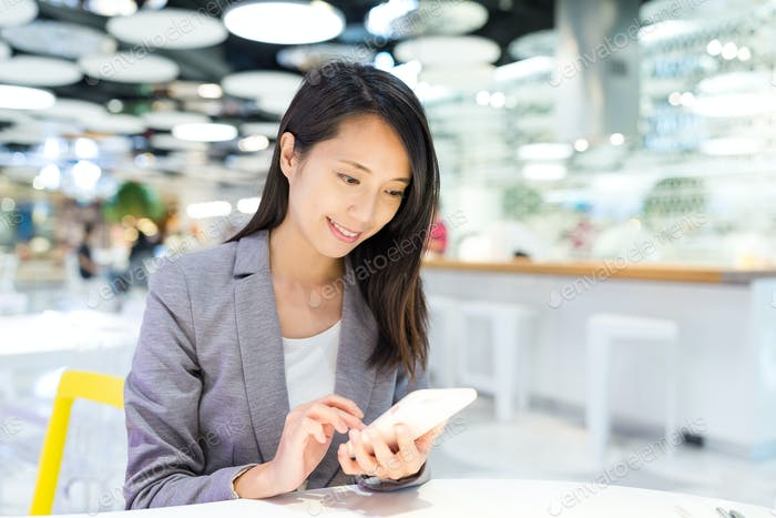 Businesswoman use of cellphone in co working space