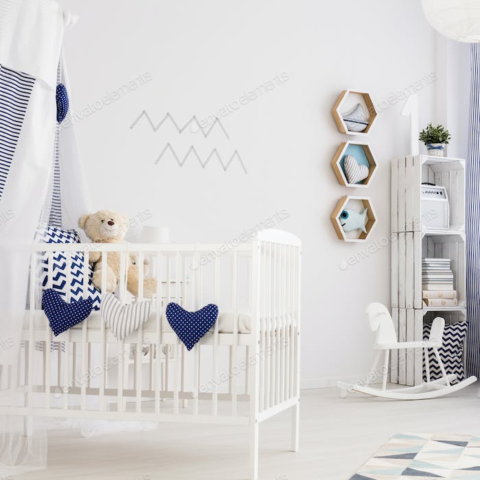 White baby room with toys
