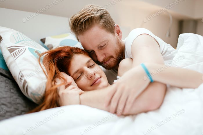 Beautiful happy couple in bed