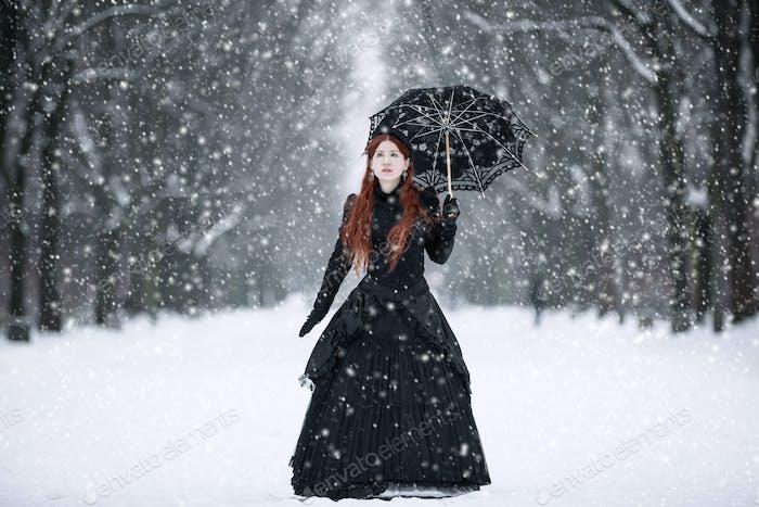 Woman in Victorian Dress in a Winter Park