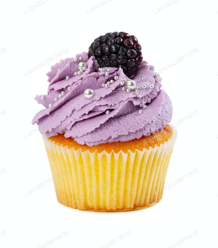 Cupcake with fresh blackberries and silver ball sprinkles