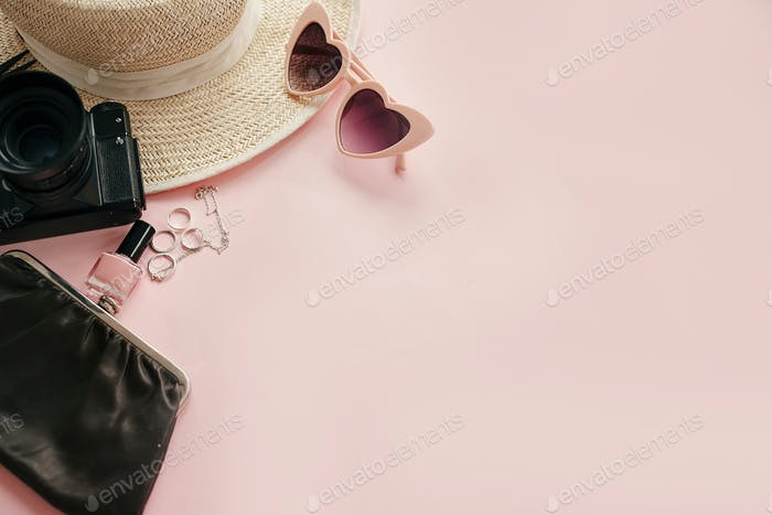 Stylish girly image with photo camera, retro pink sunglasses, jewelry