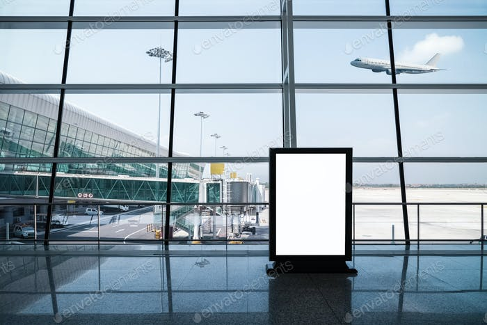 blank advertising light box on modern airport terminal