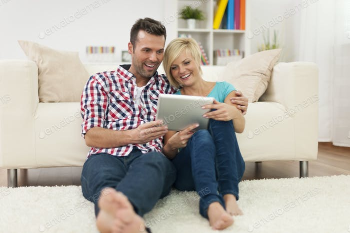 Beautiful couple at home with digital display