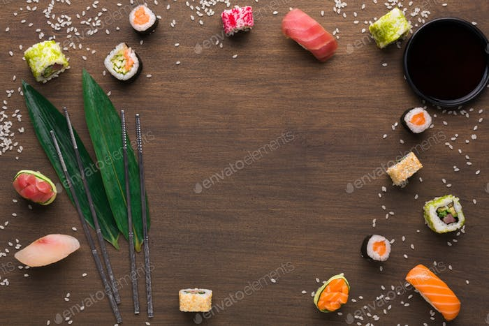 Asian food frame on wooden background