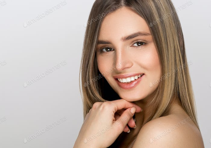 Beauty woman with healthy skin portrait isolated on gray background