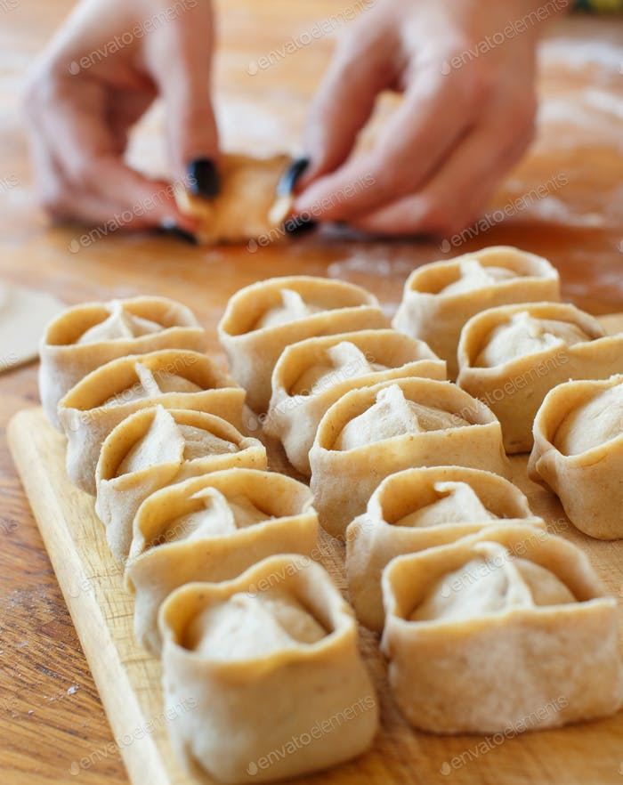Making dumplings manti