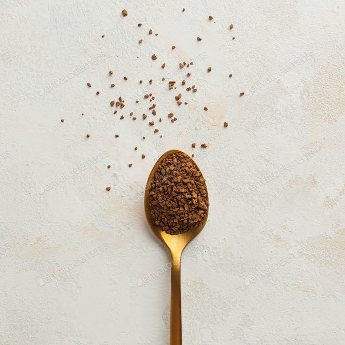 Instant coffee in a Golden spoon. Concept of instant coffee birthday celebration.