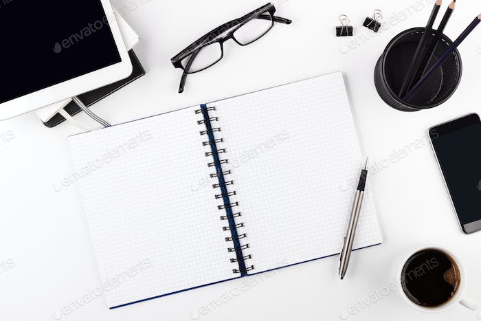 White office desk with empty notepad