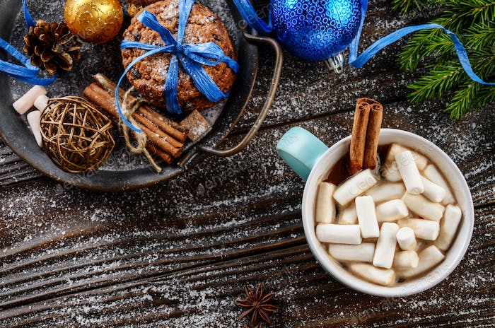 Flat lay Christmas background of blue mug with hot chocolate and marshmallows