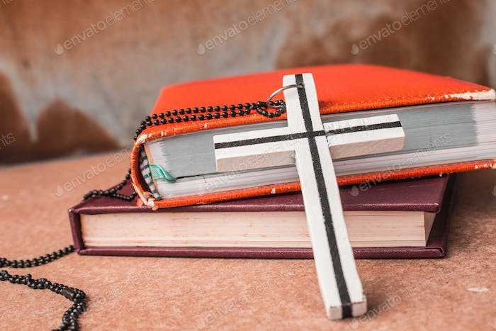 Crosses and books