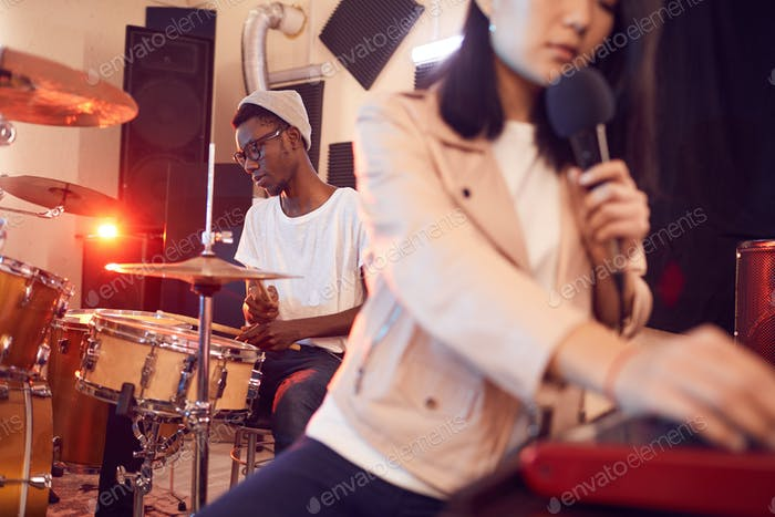 Music Band Working in Studio