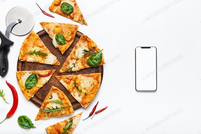 Italian food delivery. Pizza slices and smartphone with blank screen